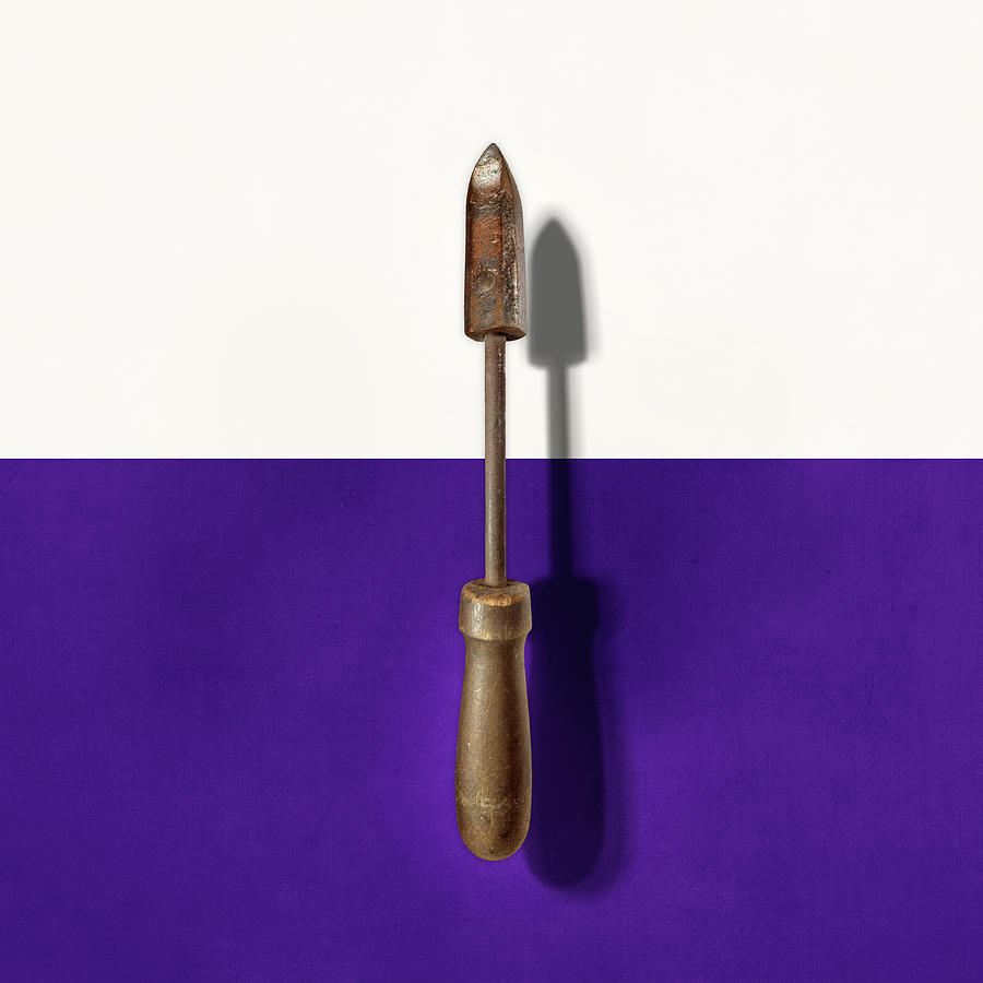Antique Soldering Iron On Color Paper Photograph