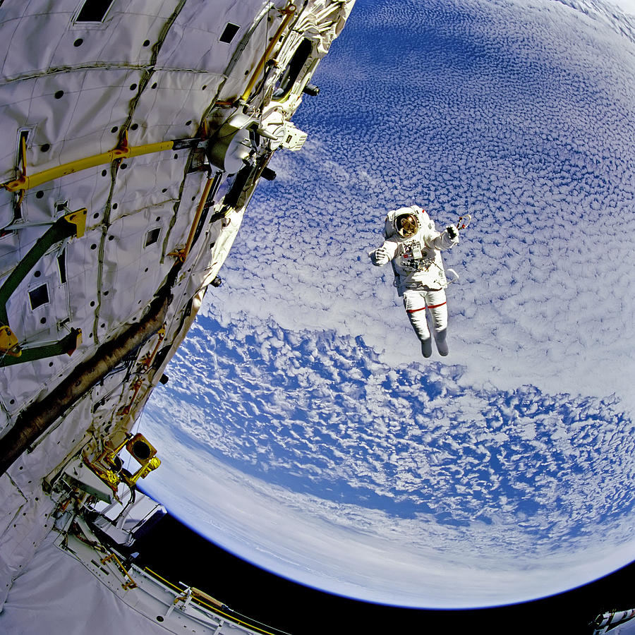 Extravehicular Activity Photograph - Astronaut In Atmosphere by The  Vault - Jennifer Rondinelli Reilly