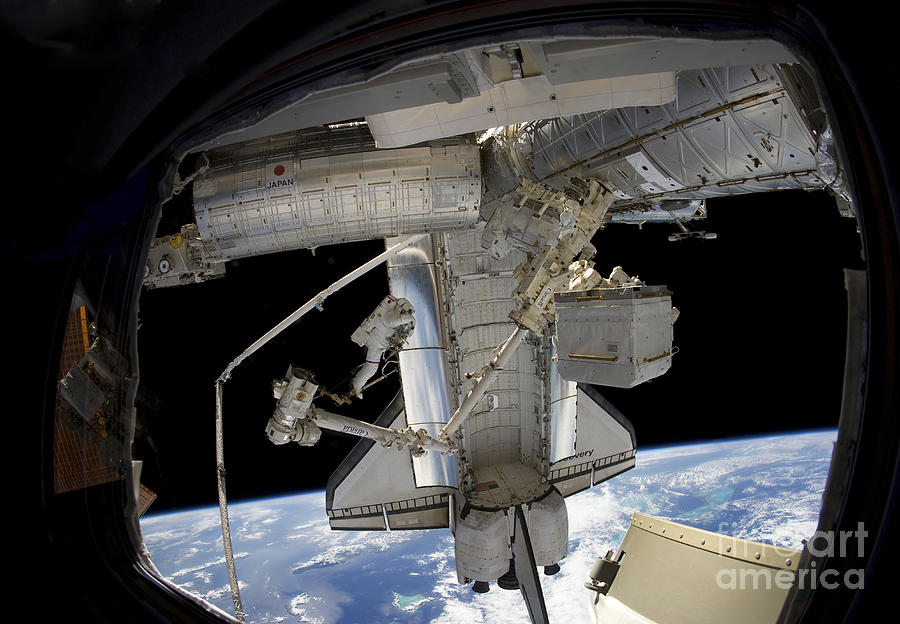 View From Space Photograph - Astronaut Participates In A Spacewalk by Stocktrek Images