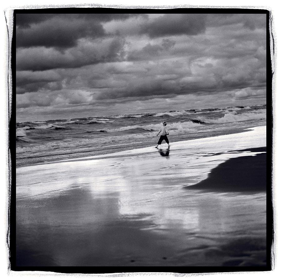 Beach Photograph - Boy On Shoreline by Steve Gadomski