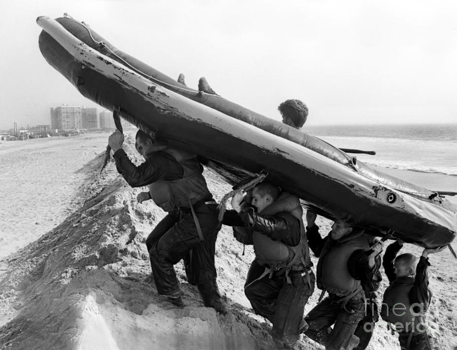 Military Photograph - Buds Students Carry An Inflatable Boat by Michael Wood