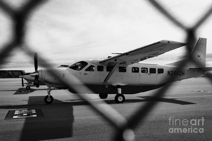 Aircraft Photograph - cessna 208B sightseeing tour aircraft at Grand canyon west airport Arizona USA by Joe Fox