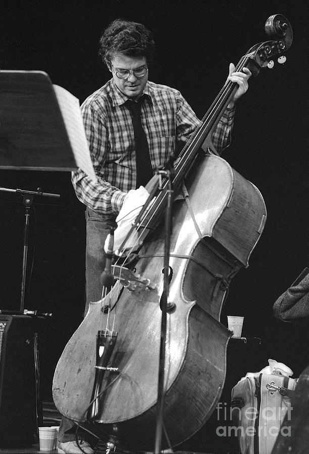 Charlie Haden Takes Care Of His Doublebass Photograph