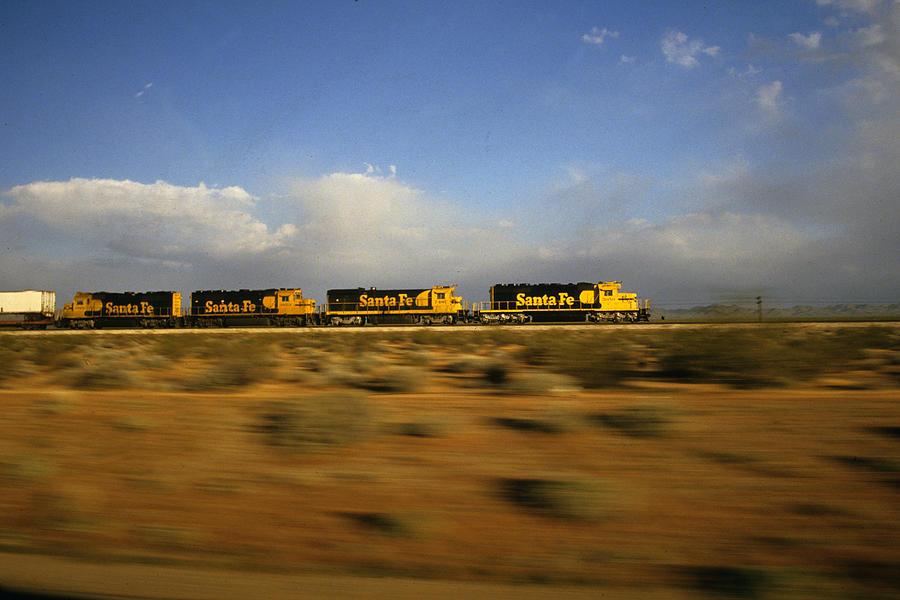 Railroads Photograph - Chasing The Desert Wind by Susan  Benson