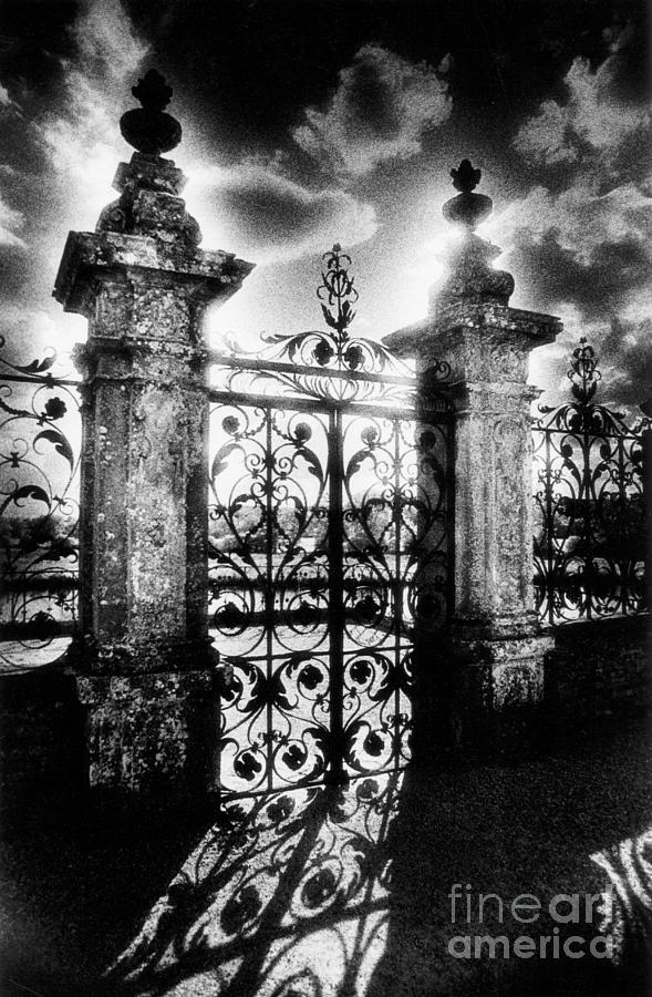 Gate; Wrought Iron; Posts;  Pillars; Entrance; Portal; Grand; Grandiose; French; Metalwork; Ornate; Atmospheric; Spooky; Eerie; Fairytale; Moonlit; Moonlight; Dramatic; Portal; Castle; Renaissance; Baroque Photograph - Chateau De Carrouges by Simon Marsden