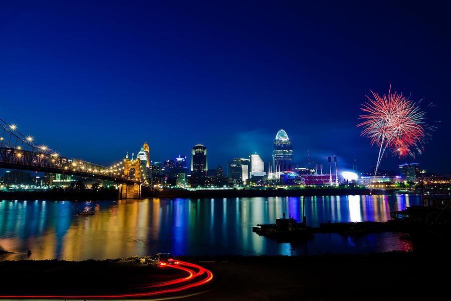 Cincinnati Ohio Skyline Fireworks Twilight Light Trails Water River Reflection Photograph - Cincinnati Boom by Keith Allen