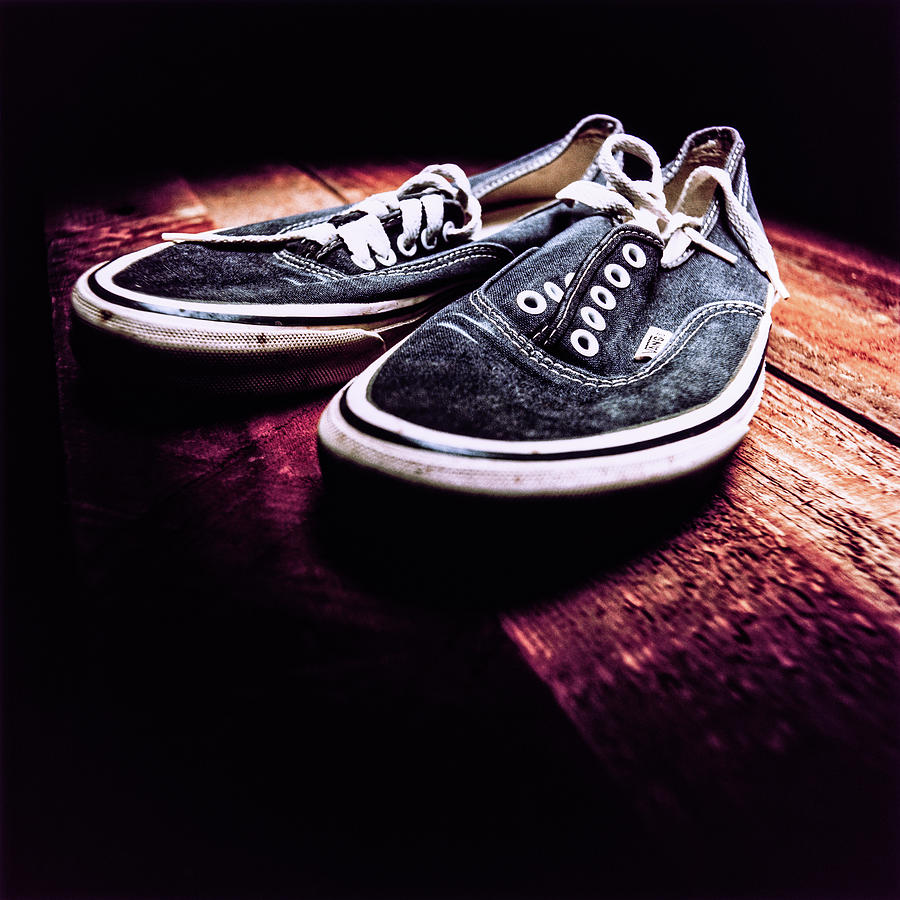 Classic Vintage Skateboard Shoes On Wood Photograph