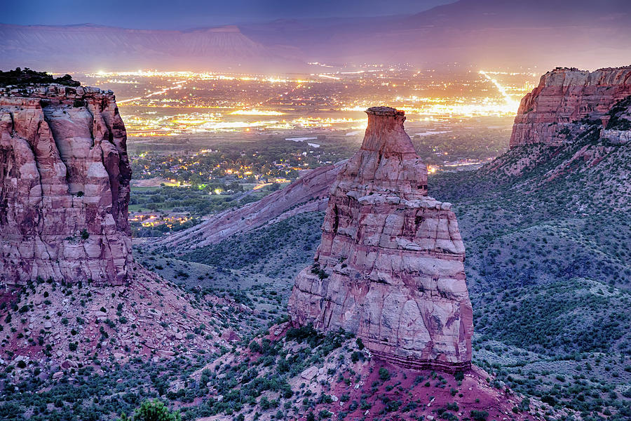 Colorado Independence Monument And City Lights Of Grand Junction Photograph