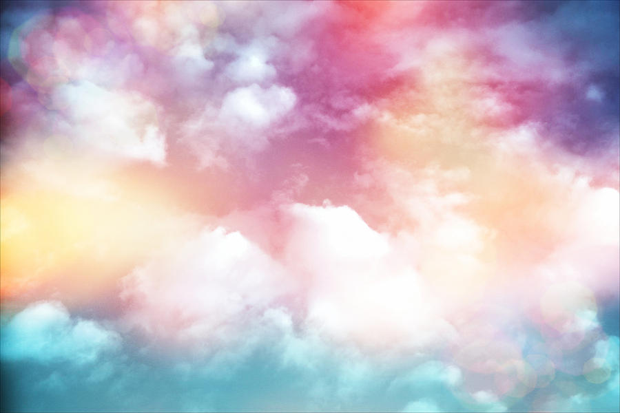Colorful Clouds With Lens Flare Photograph by Serena King