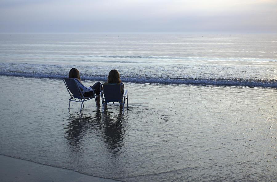 Denmark, Romo, Two Young Women Relaxing Photograph