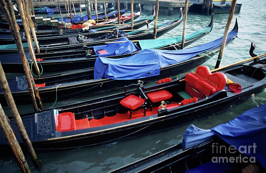 Empty Gondolas Floating On Narrow Canal Photograph