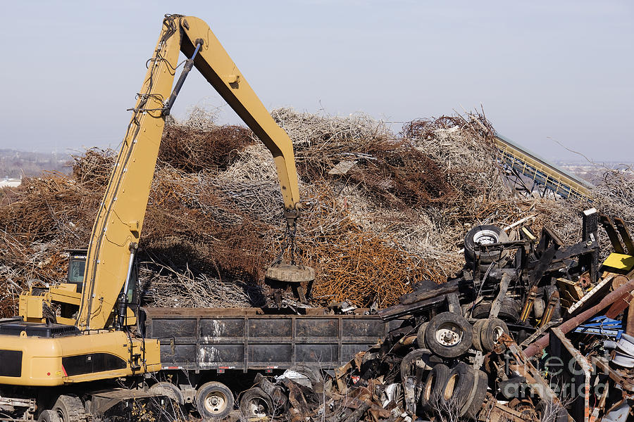 Excavator Moving Scrap Metal With Electro Magnet Photograph