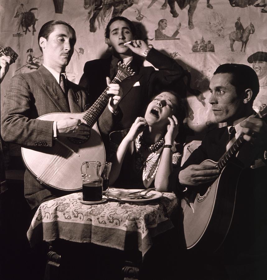 History Photograph - Fado Singer In Portuguese Night Club by Everett
