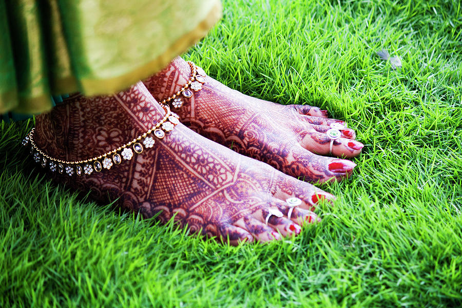 Feet With Mehndi On Grass Photograph
