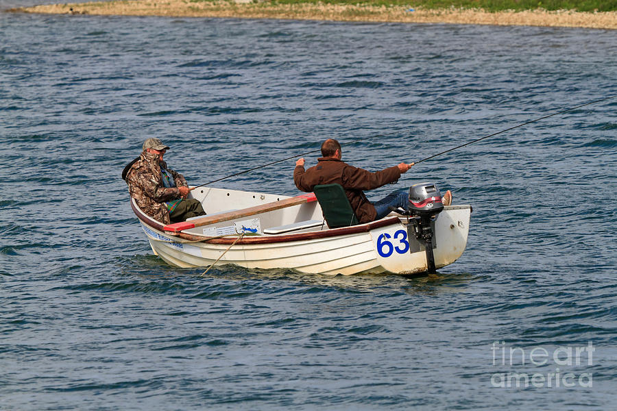 Fishermen Photograph - Fishermen In A Boat by Louise Heusinkveld
