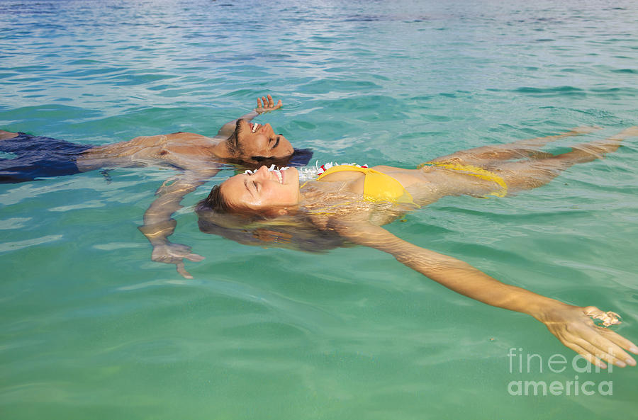 Asian Photograph - Floating Young Couple by Tomas del Amo - Printscapes