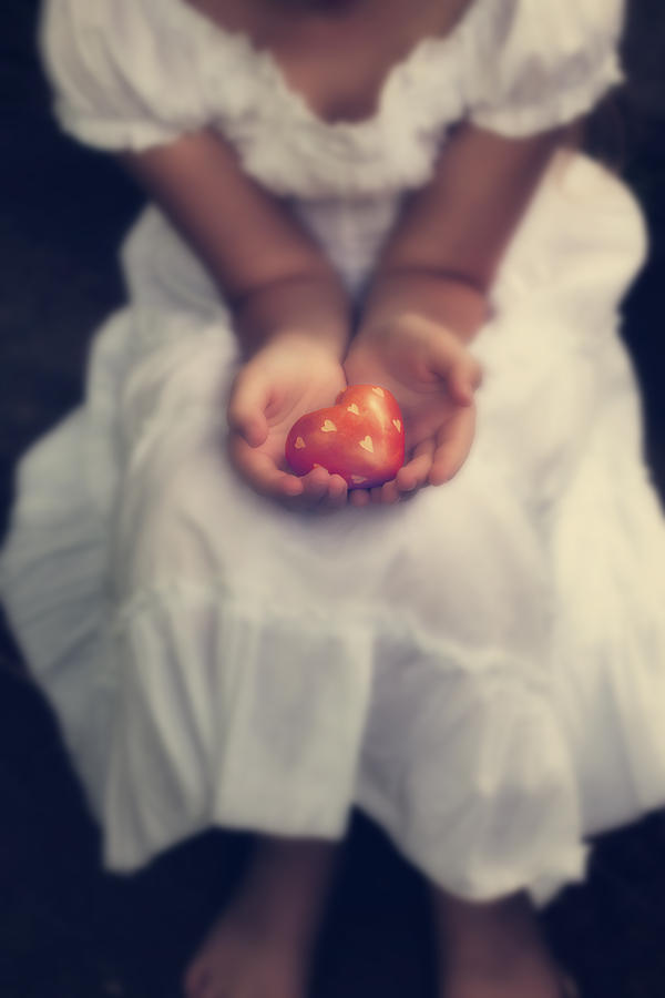 Girl Is Holding A Heart Photograph
