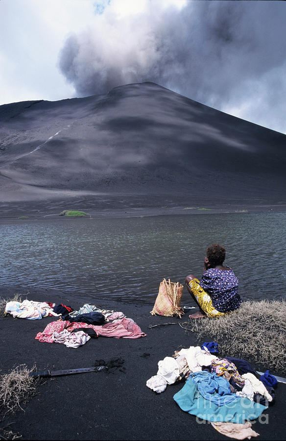 Active Volcano Photograph - Girl Washing Clothes In A Lake With The Mount Yasur Volcano Emitting Smoke In The Background by Sami Sarkis