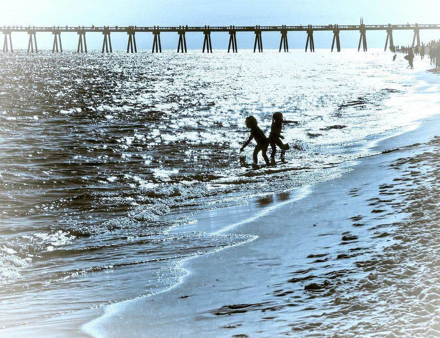 Beach Photograph - Girls Play by Kathy Bassett