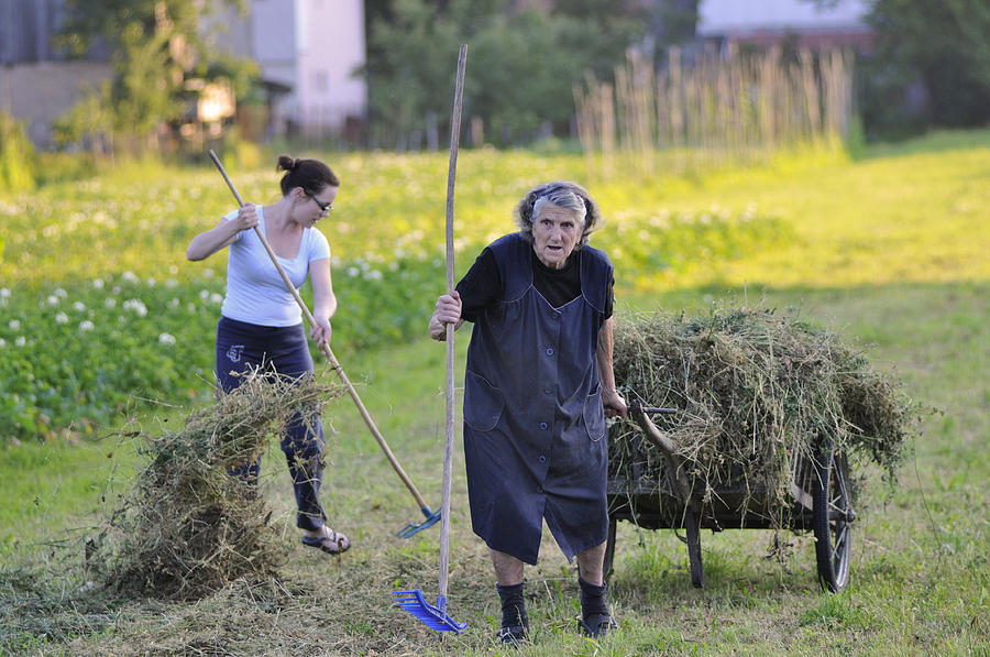 Gerovo Photograph - Granddaughter And Grandmother Sharing The Load by Don Wolf