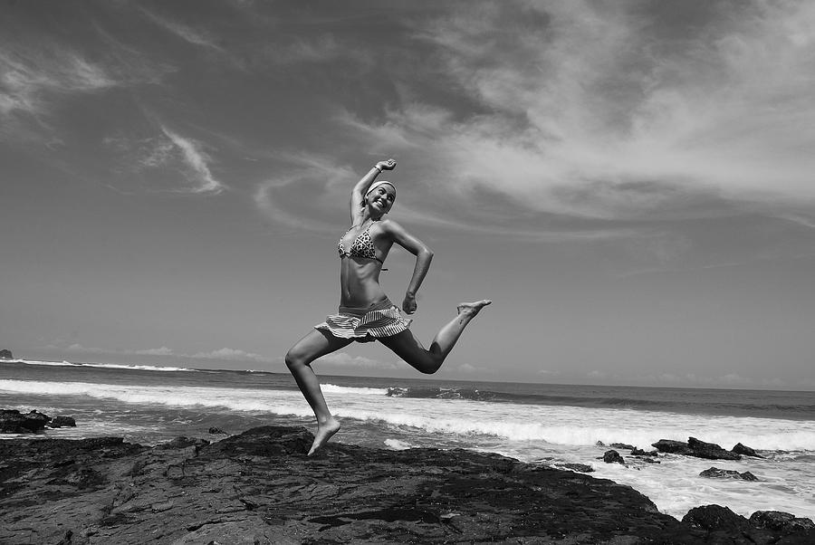Flower Photograph - Jumping by Cesar Marino