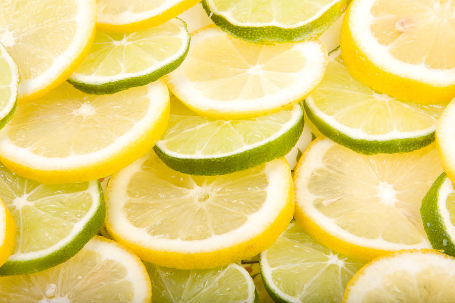 Lemons; Citrus; Citrus Fruit; Citrus Fruits; Close Up; Cross Section; Culinary; Food; Fruit; Fruits; Green; Key Lime; Key Limes; Lime; Limes; Slice; Sliced; Slices; Group; Sour Photograph - Lemons And Limes by James BO  Insogna