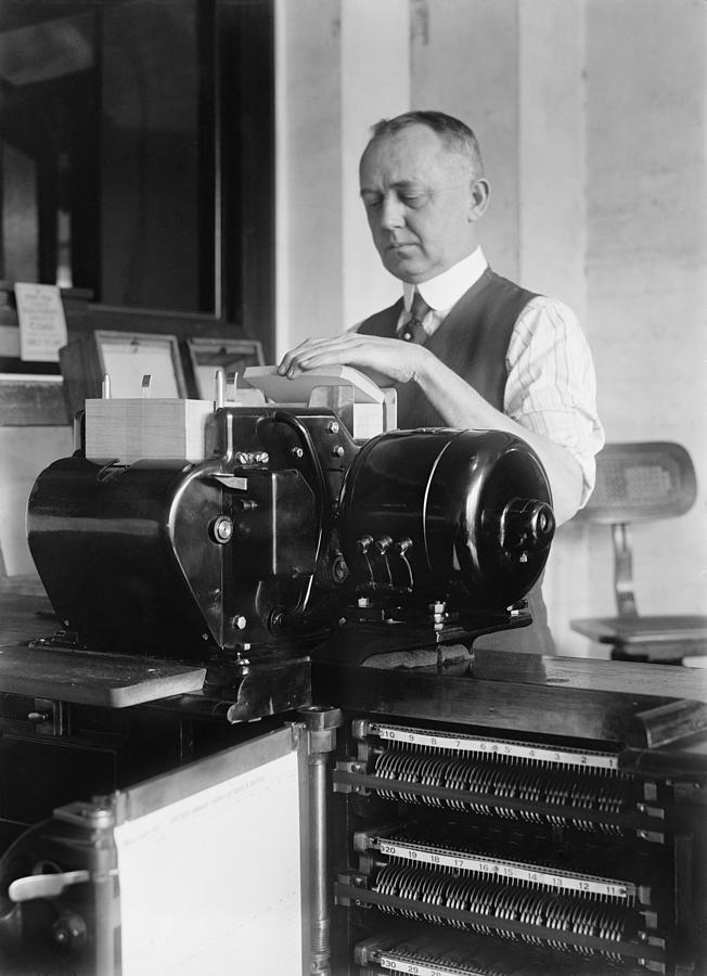 History Photograph - Man Loading Punch Cards by Everett