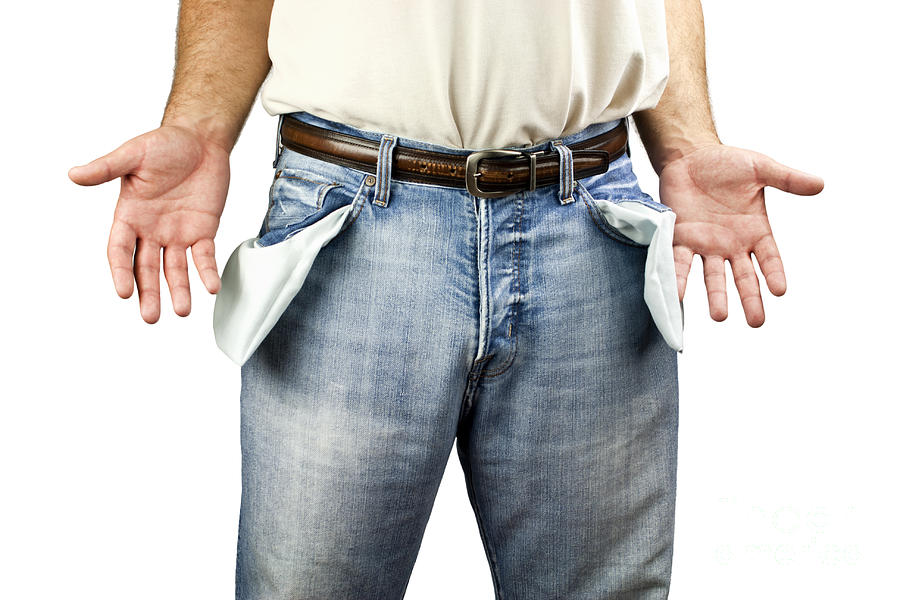 Bankruptcy Photograph - Man With Empty Pockets by Blink Images