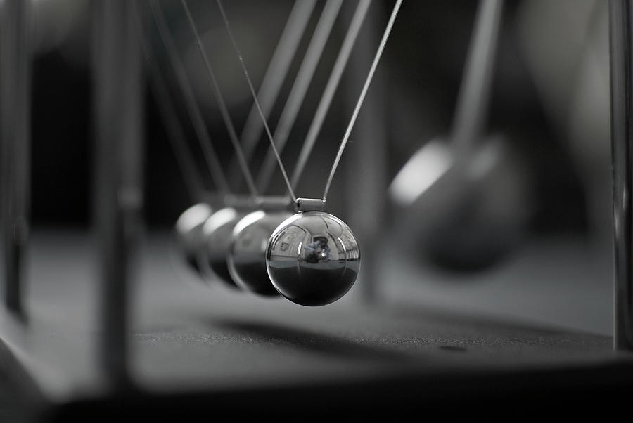 Newtons Cradle In Motion - Metallic Balls Photograph