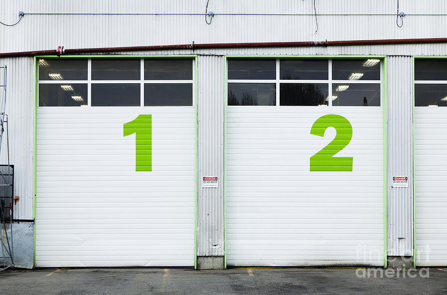 1 Photograph - Numbers On Repair Shop Bay Doors by Don Mason
