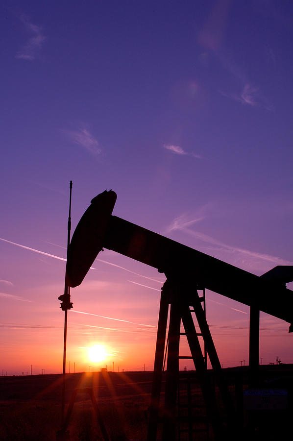 Oil Field Photograph - Oil Rig At Sunset by Connie Cooper-Edwards