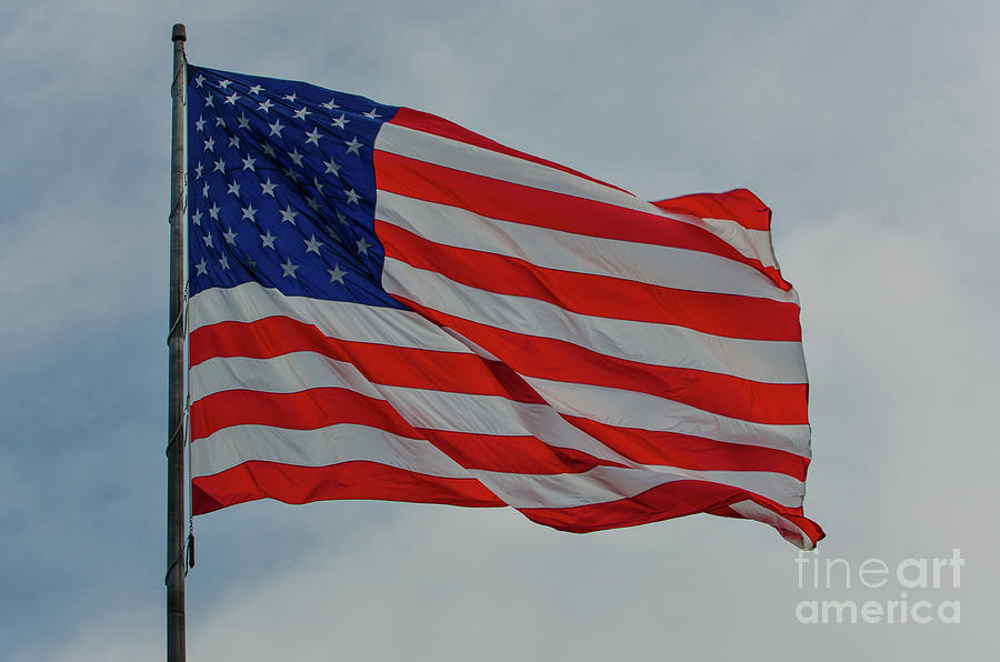 Old Glory Flapping In The Wind Over Charleston Photograph