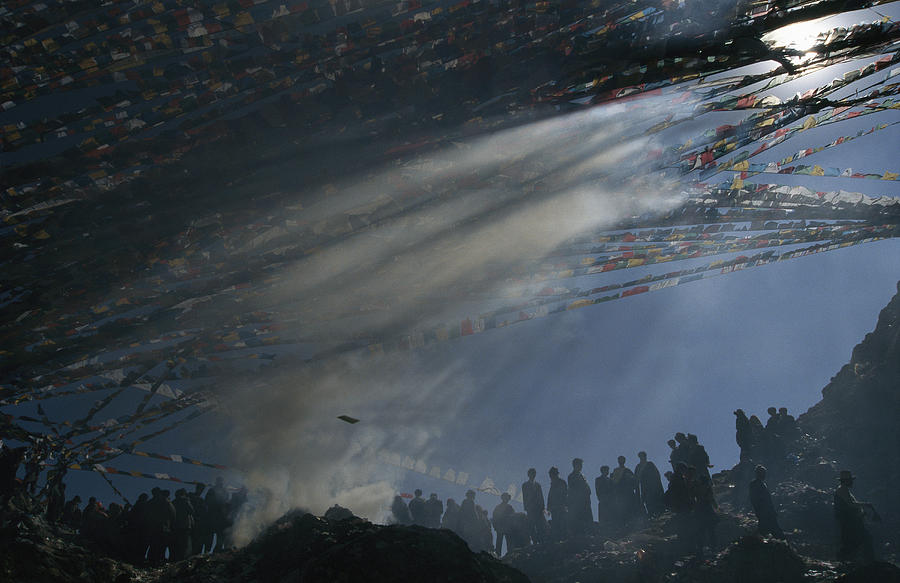 Asia Photograph - Prayer Flags Are Raised During Losar by Maria Stenzel