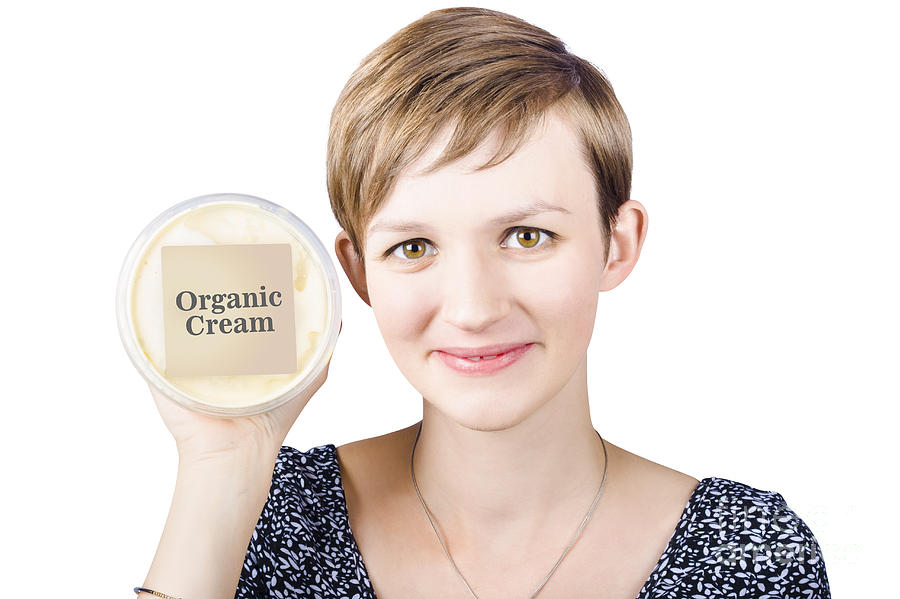 Pretty Woman Holding A Tub Of Organic Cream Photograph