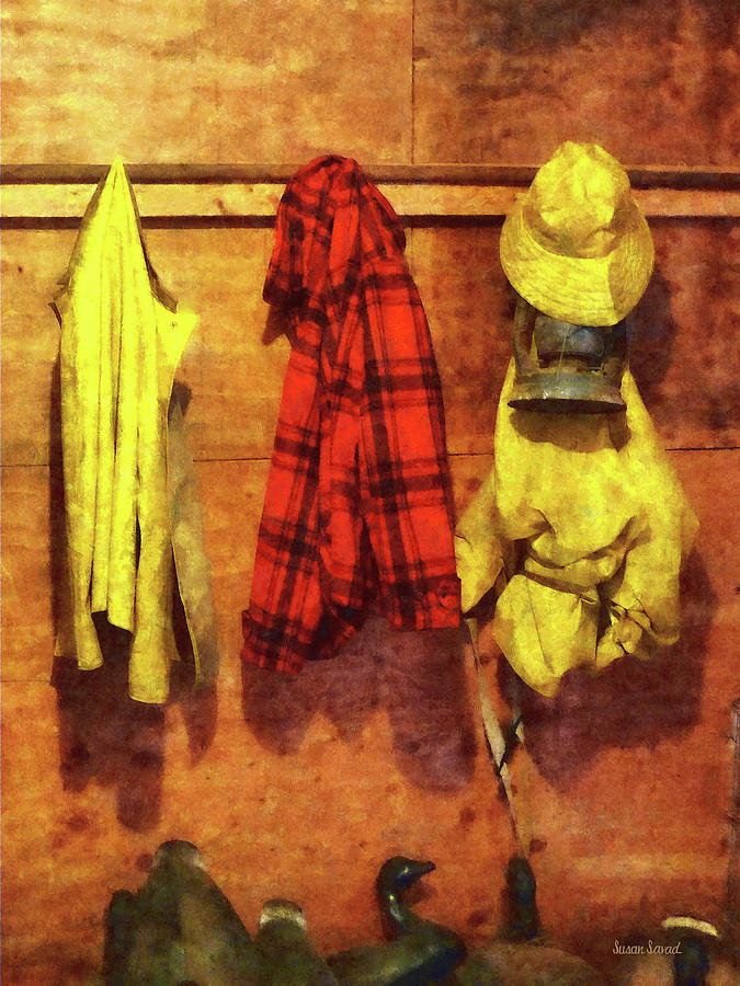 Rain Gear And Red Plaid Jacket Photograph