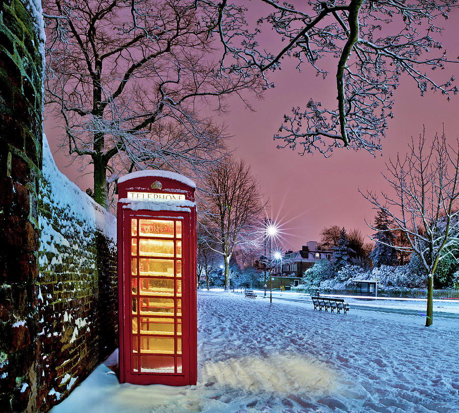 Horizontal Photograph - Red Phone Box Covered In Snow by Photo by John Quintero