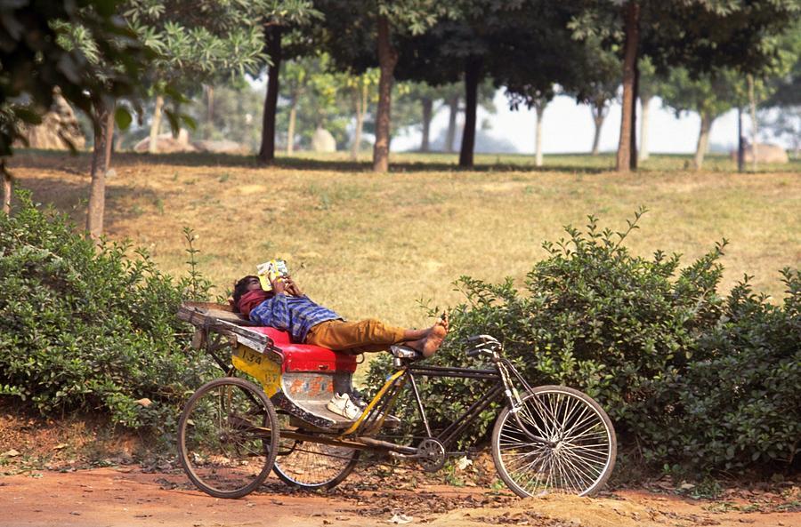 Rickshaw Rider Relaxing Photograph