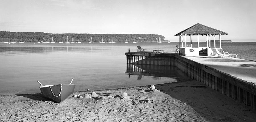 Black And White Photograph - Row Boat And Dock At Ephriam by Stephen Mack