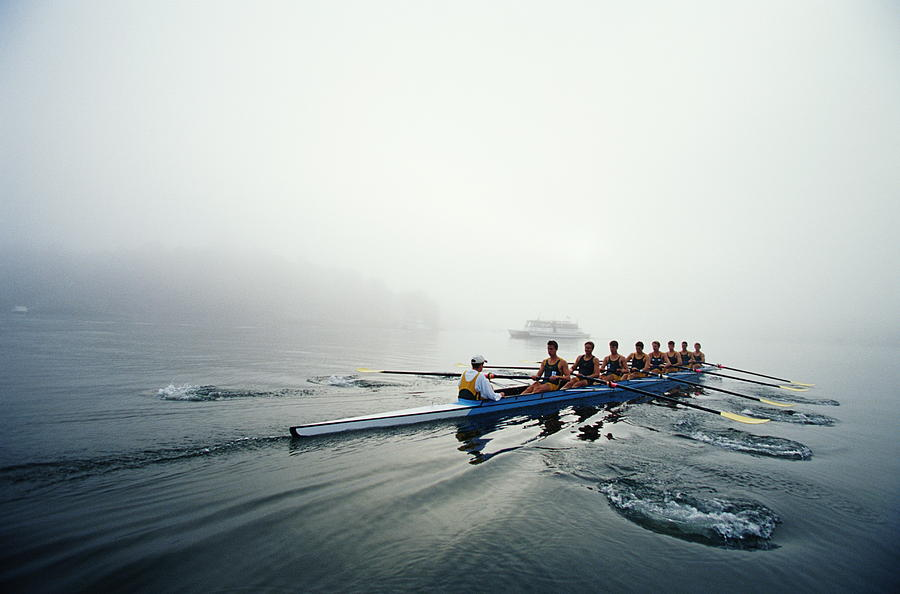 Adult Photograph - Rowing Team On Lake In Early Morning Fog by Nick Wilson