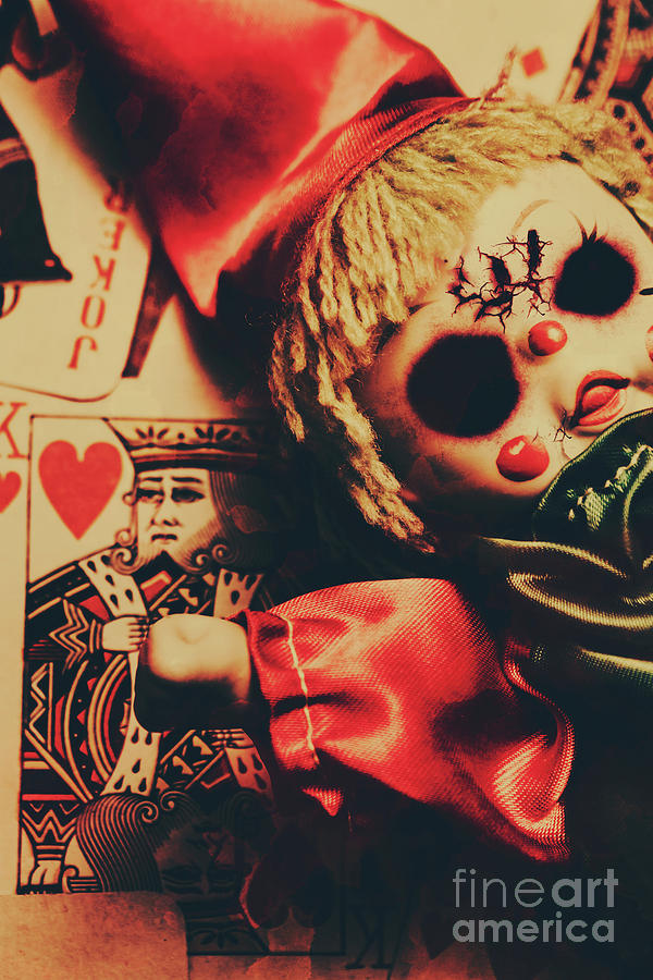 Scary Doll Dressed As Joker On Playing Card Photograph