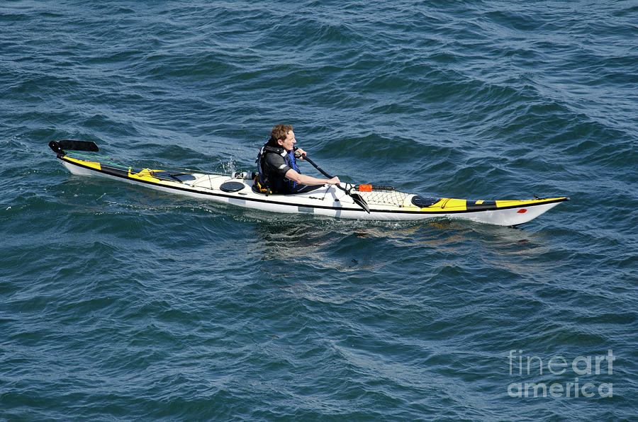 Sea Photograph - Sea Kayak Man Kayaking Off The Coast Of Dorset England Uk by Andy Smy