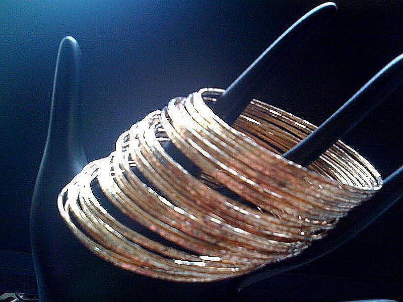 Handmade Bracelets Mixed Media - Set Of 40 Stacking Hand Hammered 14k Yellow Gold Filled Bangles Gypsy And Organic Look by Nadina Giurgiu