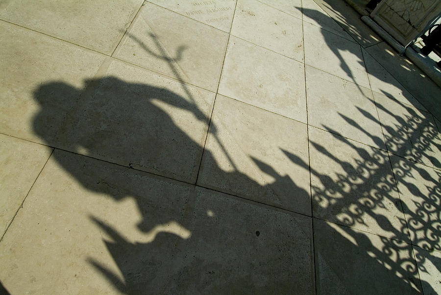 Shadow Of The Statue Of Neptune Photograph