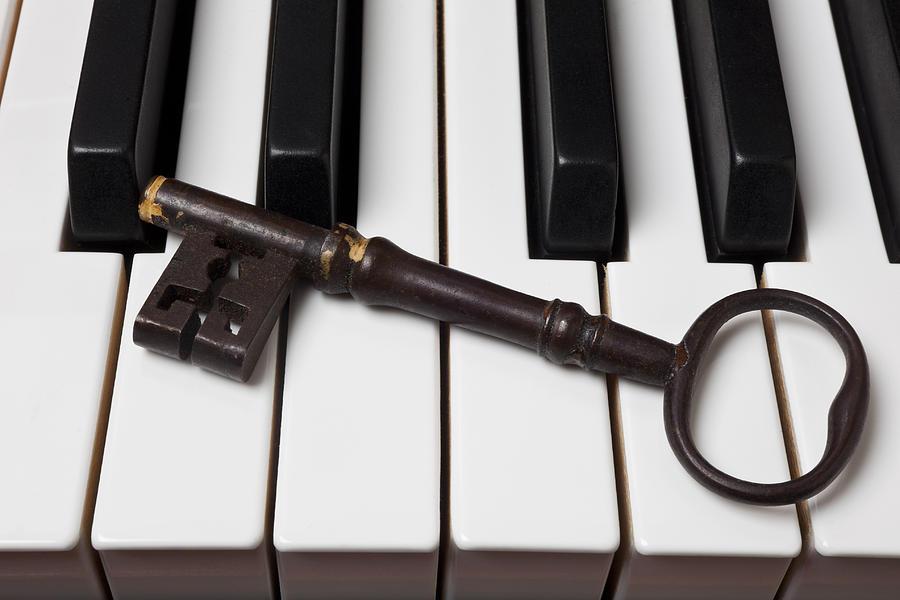 Skeleton Key Photograph - Skeleton Key On Piano Keys by Garry Gay