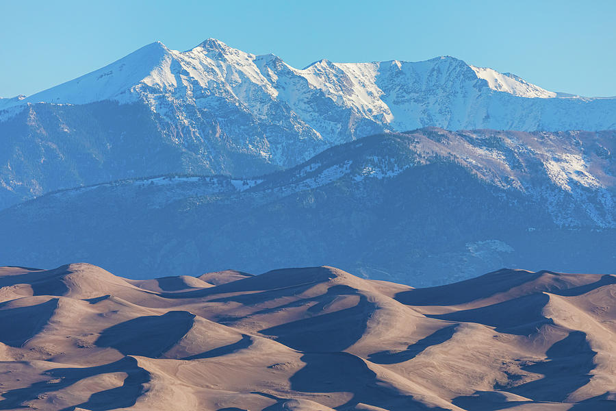 Snow Covered Rocky Mountain Peaks With Sand Dunes Photograph