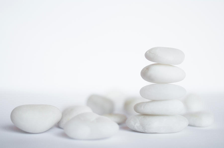 Stack Of White Pebbles On White Background Photograph