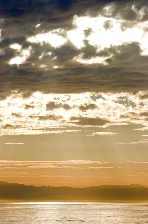 Islands Photograph - Sun Rays And Clouds Over Santa Cruz by Rich Reid