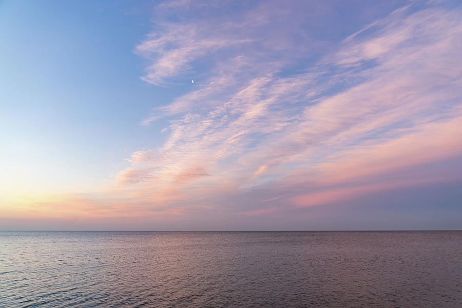 Sunrise Moonset - Feathery Clouds And Crescent Moon Over Water Photograph