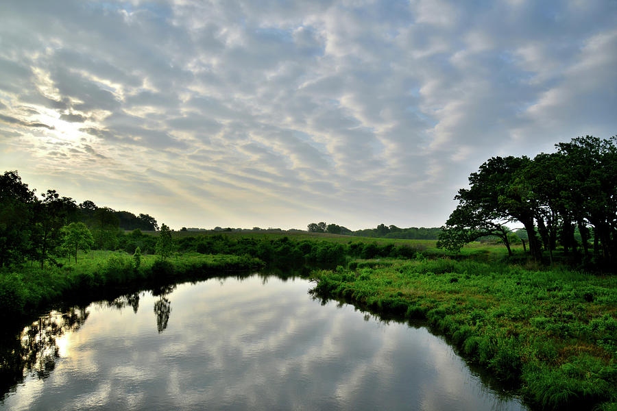 Sunrise Reflection Of Clouds In Nippersink Creek Photograph