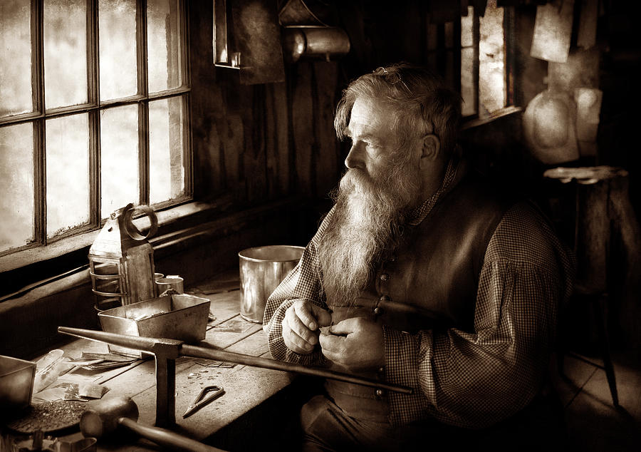 Suburbanscenes Photograph - Tin Smith - Making Toys For Children - Sepia by Mike Savad